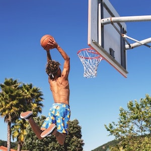 Star sales people practice all the time, just like athletes. A boy practices shooting basketball hoops. <em>Photo by Tim Mossholder on Unsplash.</em>