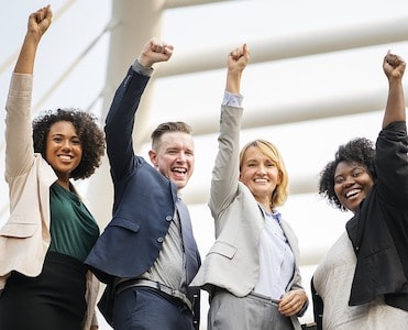 Group of successful sales people cheering themselves