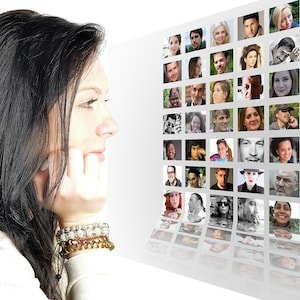 Woman looking at photo array of many generations of people showing how salespeople need to understand each generation