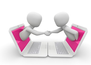 Two characters popping out of laptop screens and shaking hands showing success in virtual selling